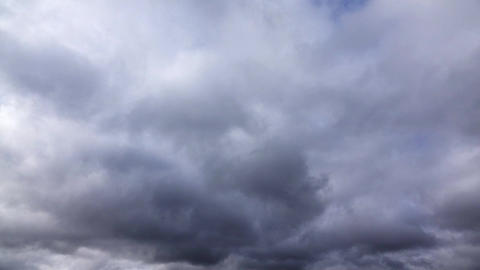 Multilayer clouds slide fast, gather to dark rainy skies, timelapse shot Footage