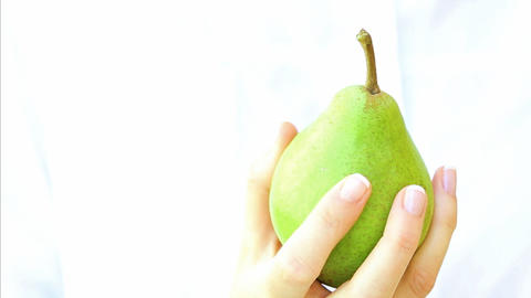 Pear in woman's hand Footage