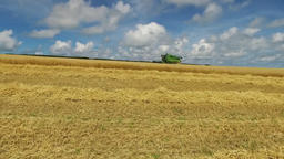Combine harvester harvesting, from right to left, a filed of ripe wheat Footage
