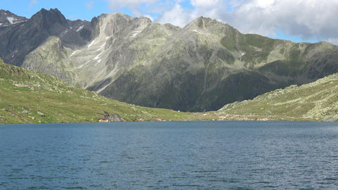 Scenic view on peak of mountains and lake in Swiss Alps Live Action