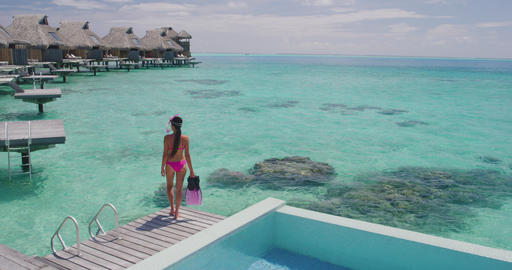 Luxury Travel Vacation in Tahiti. Snorkel swim woman going snorkeling Live Action