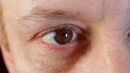 Middle-aged man's brown eye. Close-up. Macro.European Live Action