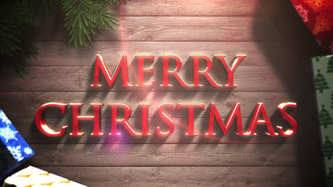Animated closeup Merry Christmas text, gift boxes and green tree branches Animation