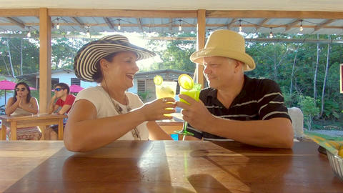 Couple Of Adorable Adults Toasting At A Bar Counter In A Lodge In Ecuador Live Action