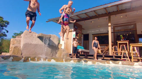 Tourists Having Fun Jumping In A Pool Of A Lodge In The Ecuadorian Amazon Live Action