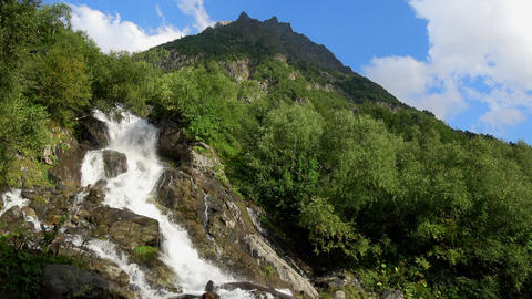 View waterfall scenes in mountains, national park Dombay, Caucasus, Russia Footage