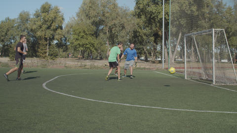 Soccer ball hitting goalpost after kick during game Live Action