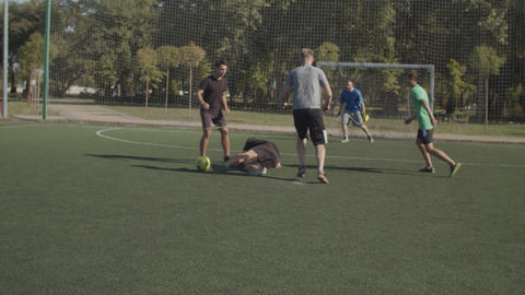 Foul committed by soccer defender against opponent Live Action