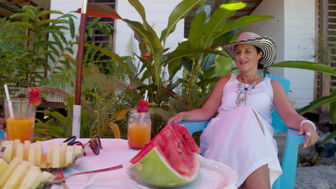 Two Women Enjoying A Tropical Breakfast By A Pool In A Lodge Footage