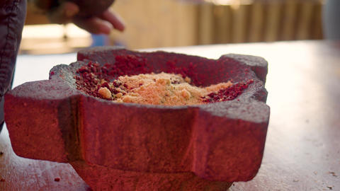 Hands Mixing Brown Sugar With Ground Cocoa In A Mortar Live Action