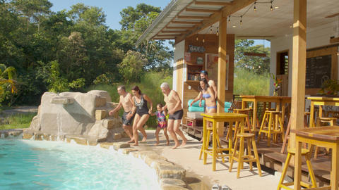 Tourists Jumping Into A Pool At A Lodge In The Ecuadorian Amazon Live Action