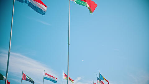 Flags of the world countries blowing in the wind - clear blue sky Footage