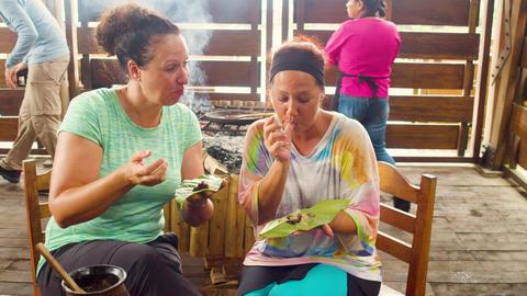 Women Tourists Tasting Fresh Handmade Cocoa Paste Live Action