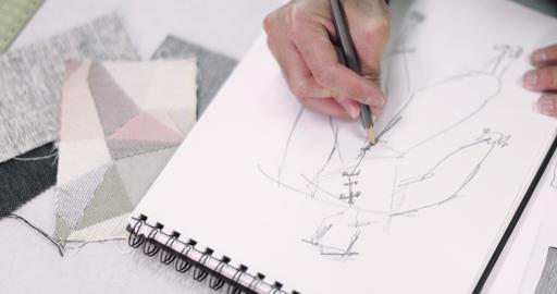 Overhead shot fashion designer sketching a design Footage