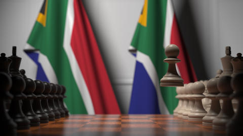Flags of South Africa and South Africa behind pawns on the chessboard. Chess Live Action