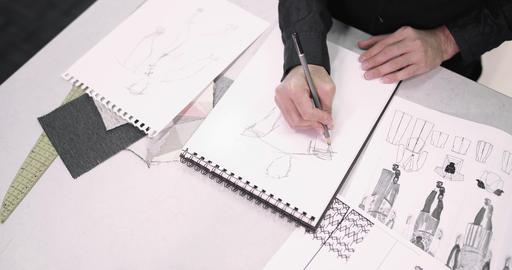 Overhead shot fashion designer sketching a design Live Action