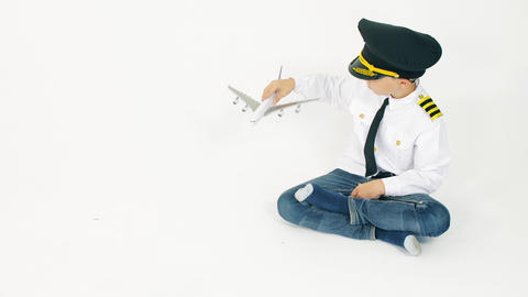 Boy in pilot's uniform lands scale commercial airplane Live Action