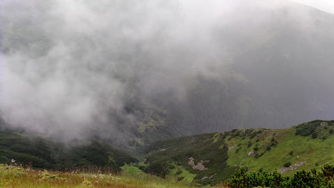 Cloud movement in rain Mountain ranges in cloudy weather near lake Live Action