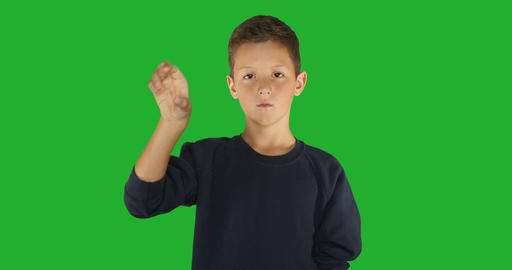 Deaf boy signing I know sign language, communication for hearing impaired. Green Live Action