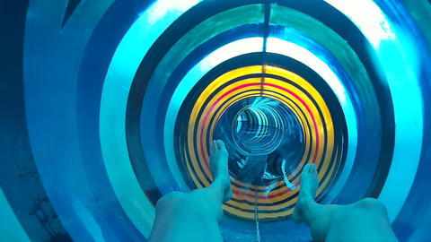 POV shot of person riding in water in colorful slide tube Live Action