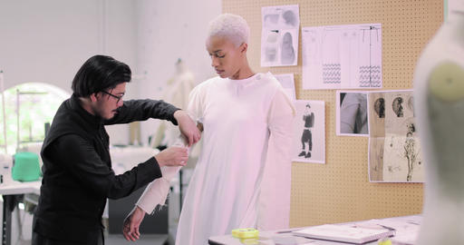 Fashion designer working on design with a model Footage