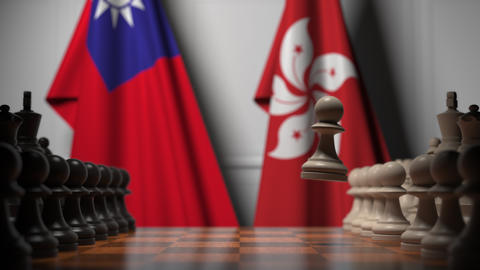 Flags of Thailand and Hong Kong behind pawns on the chessboard. Chess game or Footage
