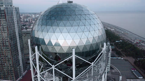 Alphabet Tower in Batumi. Drones fly overhead Live Action