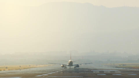 Airplane on heat runway at airport Live Action