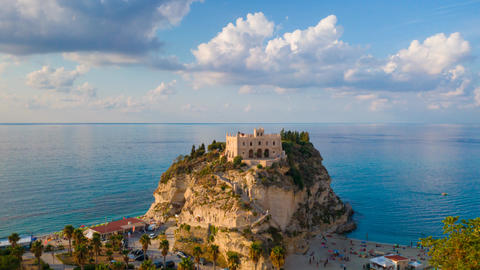 Timelapse with sea, clouds and view on rock mountain with the Sanctuary of Santa Maria dell'Isola Live Action
