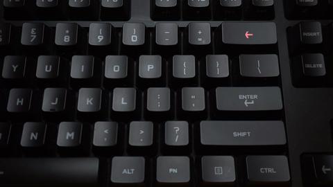 Key blinks Backspace on glowing computer keyboard Live Action