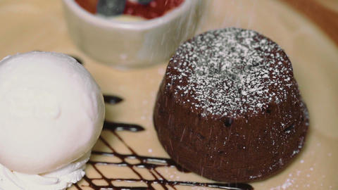 Chocolate lava cake Fondant Served with Ice Cream. Sprinkle with icing sugar Live Action