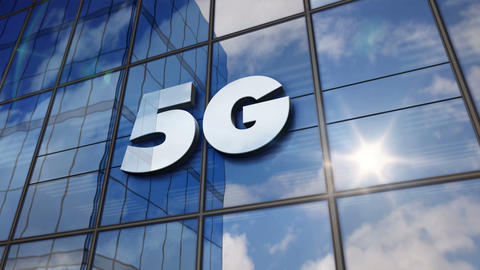 5G mobile communication symbol on glass wall and mirrored building Animation