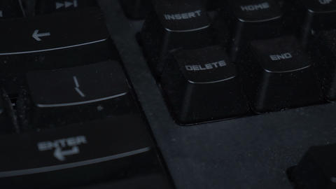 Key blinks delete on glowing computer keyboard Live Action