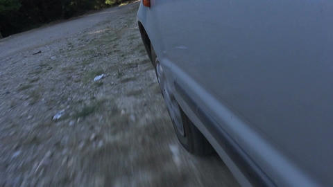 Car Wheel on Dirt Road Footage