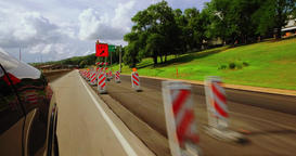 Driving Through a Single Lane Road Work Zone with Highway Cones Footage