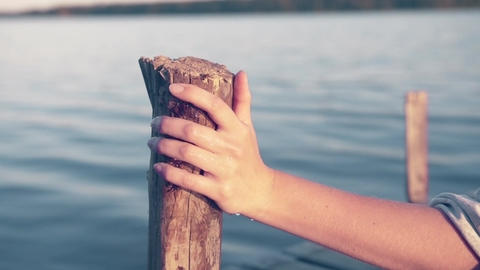 Water Drops from Female Hand on Wooden Jetty Pole Summertime - Graded Footage