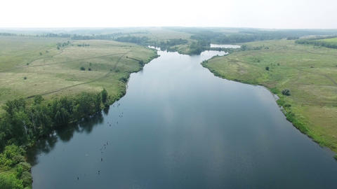 Aerial video of a big lake at countryside Live Action