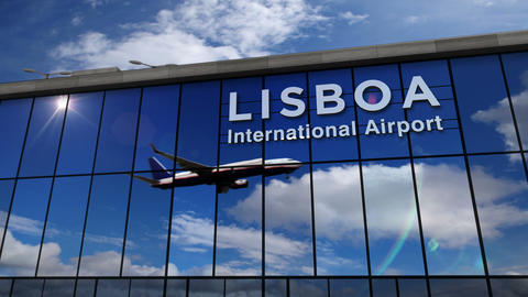 Airplane landing at Lisboa mirrored in terminal Live Action