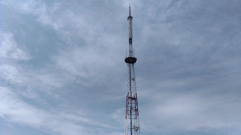 Telecommunication tower blue clouds on blue sky background Footage