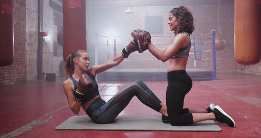 Young adult female with fitness trainer Live Action