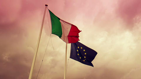waving fabric texture of the flag of italy and union europe on sky on sunset, concept of Live Action