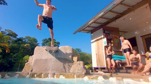 Adult Man Jumping In A Pool Of A Lodge In The Ecuadorian Amazon Live Action