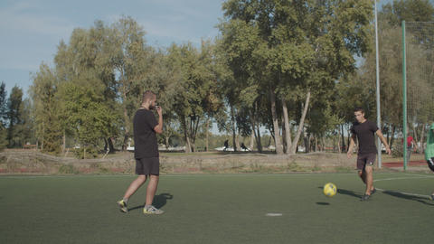 Soccer referee pointing at penalty spot during game Footage
