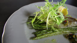 Blanched asparagus and grilled fillet of pike perch, served with lemon and herbs Live Action