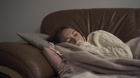 Sick young caucasian girl at home. The woman has fever. Concept of health Live Action