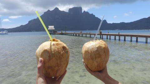 Travel icon fresh coconut water drinks at famous tourist destination Bora Bora Live Action
