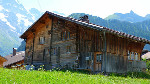 Typical Swiss cottages and barns in the Alps of Switzerland - SWISS ALPS Live Action