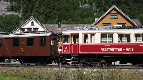 Historical train in the Swiss Alps - SWISS ALPS, SWITZERLAND - JULY 20, 2019 Live Action