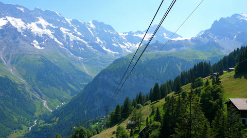 The teleferic ropeways in the Swiss Alps - SWISS ALPS, SWITZERLAND - JULY 20 Live Action