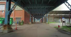 POV Driving Under Bridge in City Industrial District Footage
